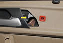 Now gently release inside the door handle cable by slightly pushing the securing tab (yellow arrow).