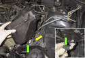 Lift the expansion tank up to detach it from the rubber mounting grommet (yellow arrow).