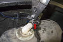 Reverse these steps to install the expansion tank.