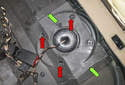 Electrical testing: Working in the rear of the vehicle interior, grab the corner of the rear seat cushion and pull it up to detach the locking tabs.