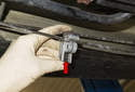 Next, use a small tubing cutter (red arrow) to cut the brake lines in a clean and rot free area.