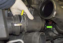 Remove the mass air flow meter from the air filter housing by sliding it in the direction of the green arrow.