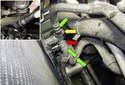 Working at the right lower side of the radiator, remove the three hoses from the automatic transmission cooler bracket (green arrows).