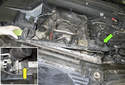 Lift the radiator mounting bracket (green arrow) up and feed the front of it out of the radiator support.