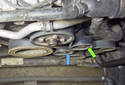 To replace the belt, the tension is released on the tensioner pulley (green arrow) and the idler Pulley (blue arrow).