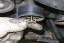Accessory belt tensioner pulleys: If you are replacing one or both of the pulleys, remove the pulley with the fastener.