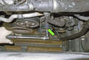 Accessory belt tensioner: Remove the upper pulley fastener.