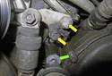 Accessory belt tensioner: Once the pulley fastener has been removed, remove the two 13mm tensioner mounting bolts (yellow arrows).