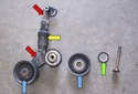 Accessory belt tensioner: This photo shows the accessory drive belt tensioner components.
