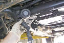 A/C belt tensioner: Once the fasteners are removed, remove the tensioner from the engine.