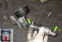 A/C belt tensioner: Remove the tension strut from the tensioner brackets.