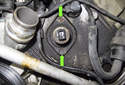 Left Side Seal: Remove the two 10mm VANOS seal fasteners (green arrows).