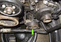 The power steering pump (green arrow) is located on the left lower side of the engine.