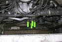 Loosen the four 10mm water pump pulley fasteners (green arrows).