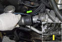 Next, remove the coolant hose from the thermostat.