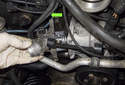 Remove the thermostat from the engine in the direction of the green arrow.