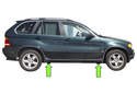 BMW X5 models have four solid plastic jacking pads, slightly behind the front wheels and slightly in front of the rear wheels (green arrows).