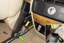 With the seat moved back into the rear foot area, disconnect the seat belt pretensioner electrical connector (yellow arrow) by pulling it straight up.