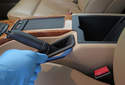 Working in the vehicle's interior, lever the top of the parking brake lever up using a plastic prying tool.