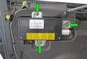 Once the door panel is removed, remove the three 10mm air bag mounting bolts (green arrows).