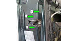 Remove the three T30 Torx door latch fasteners (green arrows).