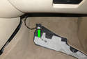 Still in the right foot well, rotate the right side carpet panel and remove the wiring harness (green arrow).