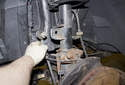Next, remove the stabilizer link from the front strut and lay it aside.