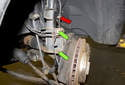 The brake hose (red arrow) has enough slack now for when you have to move the wheel-bearing carrier away from the vehicle.