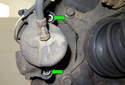 Next, using a 7mm Allen bit, remove the brake caliper mounting fasteners (green arrows).