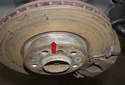 Most factory rotors and some aftermarket rotors will have a minimum thickness stamped (green arrow) on the rotor.