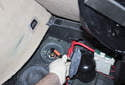 Remove the accumulator with the large line and rubber cap from the vehicle.