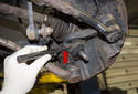 If the ball joint is stuck or seized in the spindle, use a chisel to tap it free.