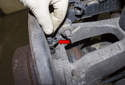 Rear sensor: Pull the ABS sensor out of the wheel bearing carrier.
