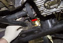 Front sway bar: Next, remove the bushing bracket (red arrow) from the sway bar bushing.