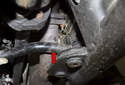 Front sway bar: Inspect the sway bar where it makes contact with the bushing (red arrow).