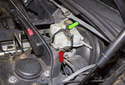 Pull the wiring harness (red arrow) out of the side of the master cylinder.