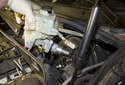 Lift the master cylinder off the brake booster while keeping the lines clear so as not to snag them.