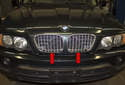The radiator grills consist of two separate grills (red arrows) mounted in the engine hood.