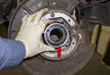 Confirm the orientation of the wheel bearing (red arrow) before pressing in the flange.