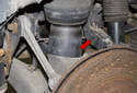 The rear control arm is the rear most upper rear control arm (red arrow) and covered in a plastic bracket.