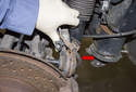 Remove the control arm from the wheel carrier.