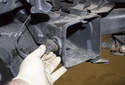 Then, pull the rubber grommet out of the duct and remove the sensor and wiring harness out of the brake duct.