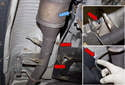 Replacing sensor after catalytic converter: To remove the sensor, start by disconnecting the electrical connector (blue arrow).