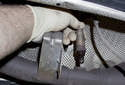 Replacing sensor after catalytic converter: Unscrew the oxygen sensor from the exhaust pipe and remove it.