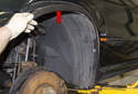 Front liner: Pull the wheel well arch (red arrow) trim away from the fender enough to clear the wheel well liner.