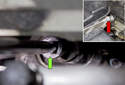 This photo shows the extension and socket (green arrow) removing the 16mm center nut.