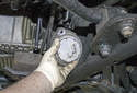Raise the engine until the engine mount can be removed from the vehicle.
