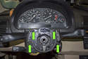 Remove the four T25 Torx fasteners (green arrows).