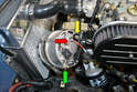 You can now remove the alternator mounting hardware and tilt the alternator forward, making sure it does not come in contact with the radiator.