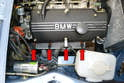 Since the M10 engine in the 2002 is a straight four all four spark plugs (red arrows) are located on the right side of the motor and can easily be replaced without removing anything else from the engine bay.